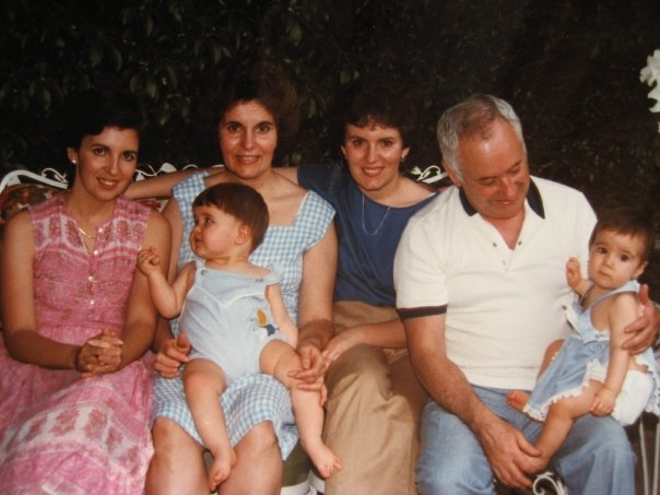 My mom, grandmother, cousin, aunt and grandfather, holding me at the right,