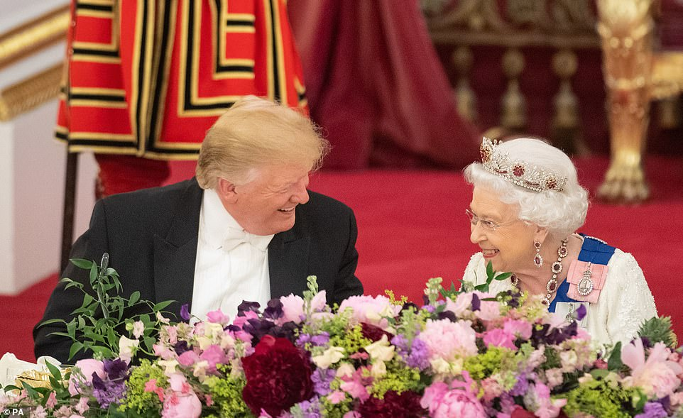 14324794-7099553-President_Trump_smiles_with_Queen_Elizabeth_II_after_praising_he-a-1_1559596478877.jpg