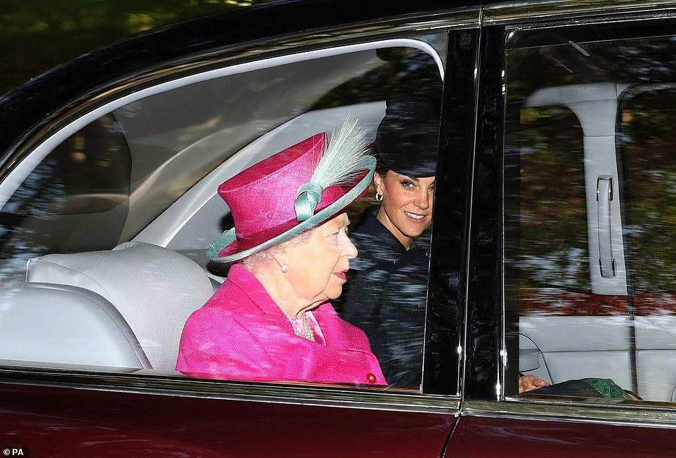 17668398-7392541-Kate_Middleton_37_looked_all_smiles_as_she_joined_the_Queen_and_-a-4_1566736502355.jpg
