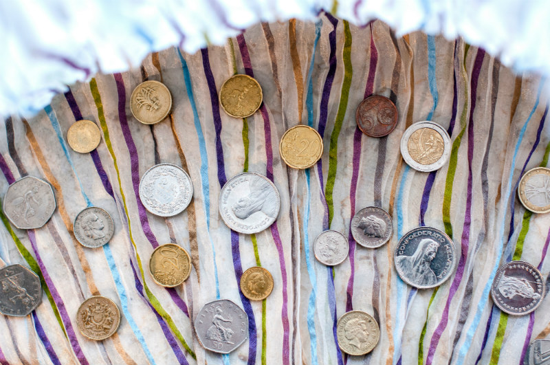traveling-on-a-budget-coins-currency.jpg