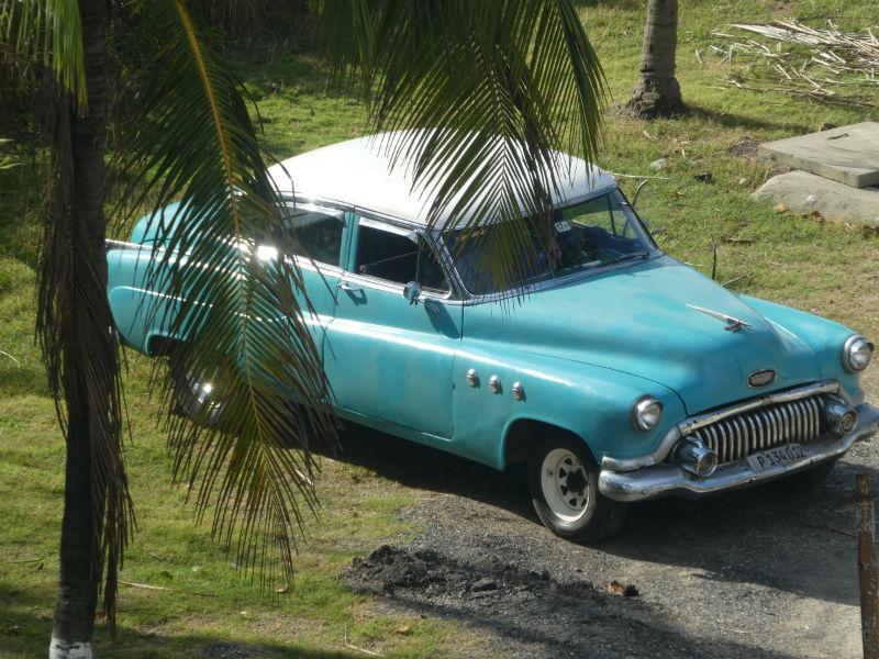 traveler-review-visiting-cuba-hugh-blue-vintage-car.jpg