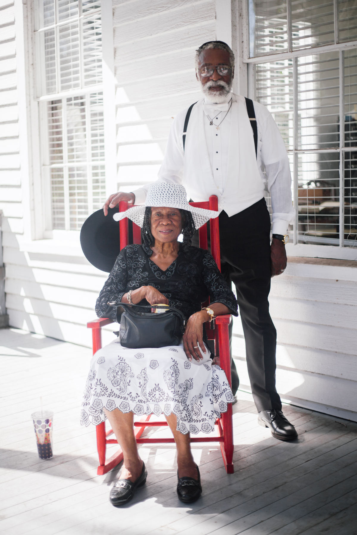 Dr. Collins serves as the chairman of the McIntosh County Historic Preservation Commission. Here, he poses for a portrait with Mrs. Eunice M. Moore, a board member of the commission, on the porch of the Burning of Darien museum that houses his office.