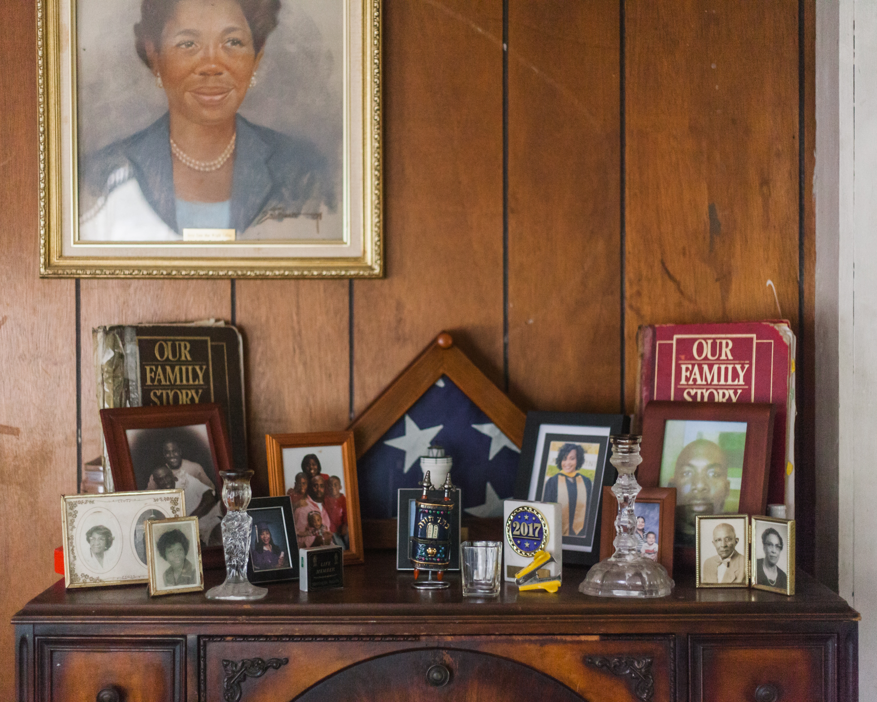 Dr. Collins is a history buff and keeps records, newspaper clippings, certificates, and other documents that he displays around his home. There are also many portraits of family members; pictured here is his aunt who raised him.