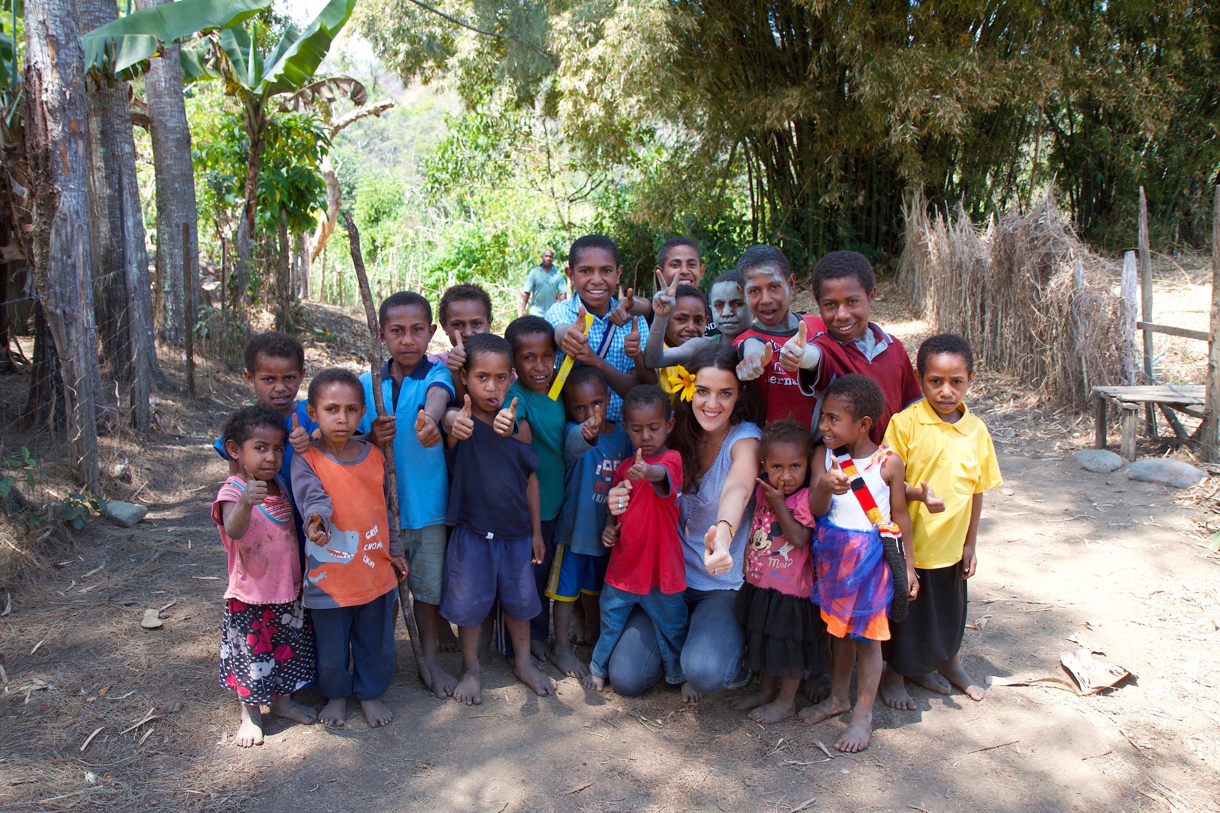 olga & village kids thumbs up in jpeg.jpg