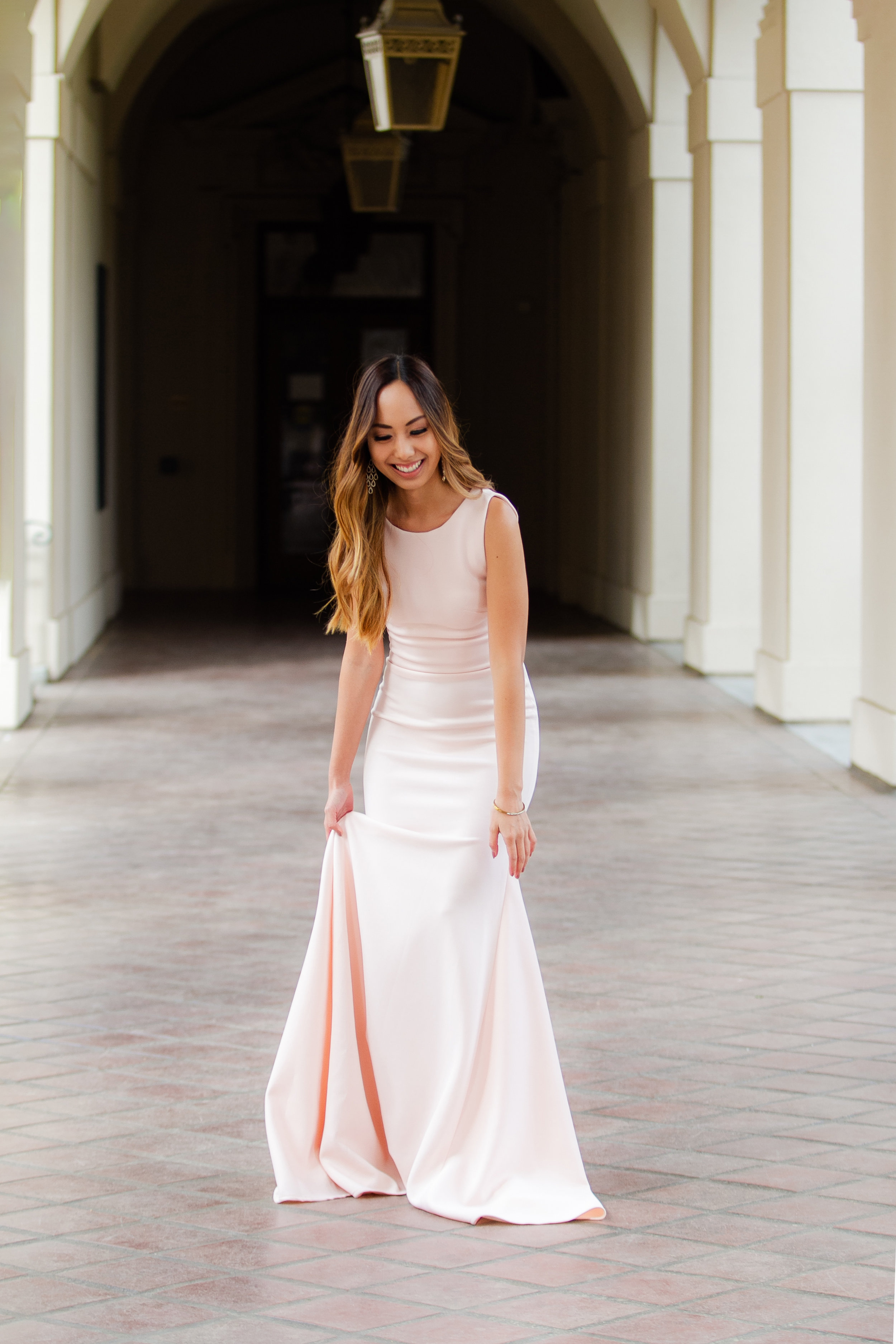 Elissa: I picked out the  Cressida dress  in a delicate blush, it is simple and very flattering.The cut really compliments your body shape, especially the mermaid tail.