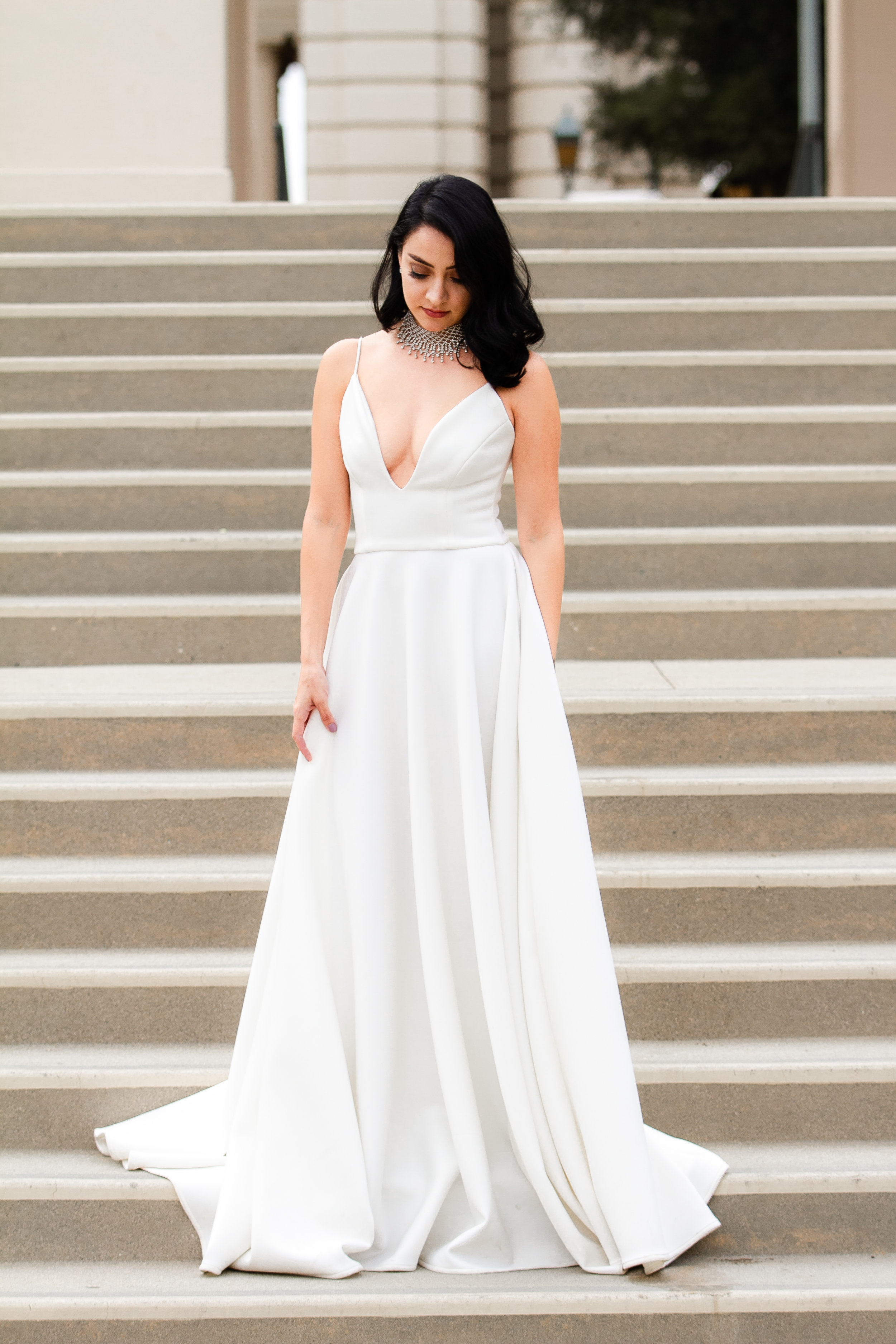 Cristina: I chose the  Evita dress , which is a simple and contemporary design. The top is structured with a plunging neckline and the back cuts into a low V shape. What really makes this dress special is the floor length skirt that gives you a beautiful feminine silhouette.