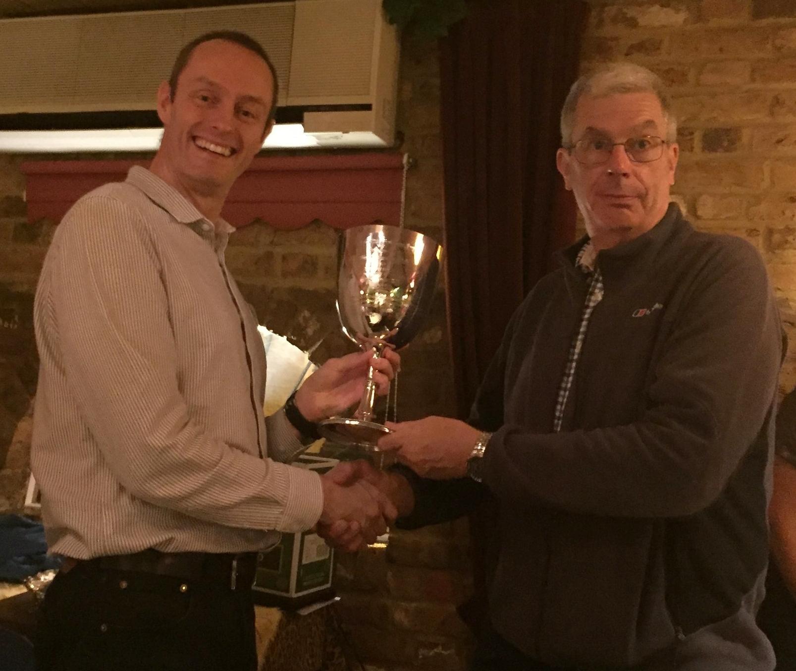 Men's mile winner Dave Warren receiving the trophy from President, Paul Hindle