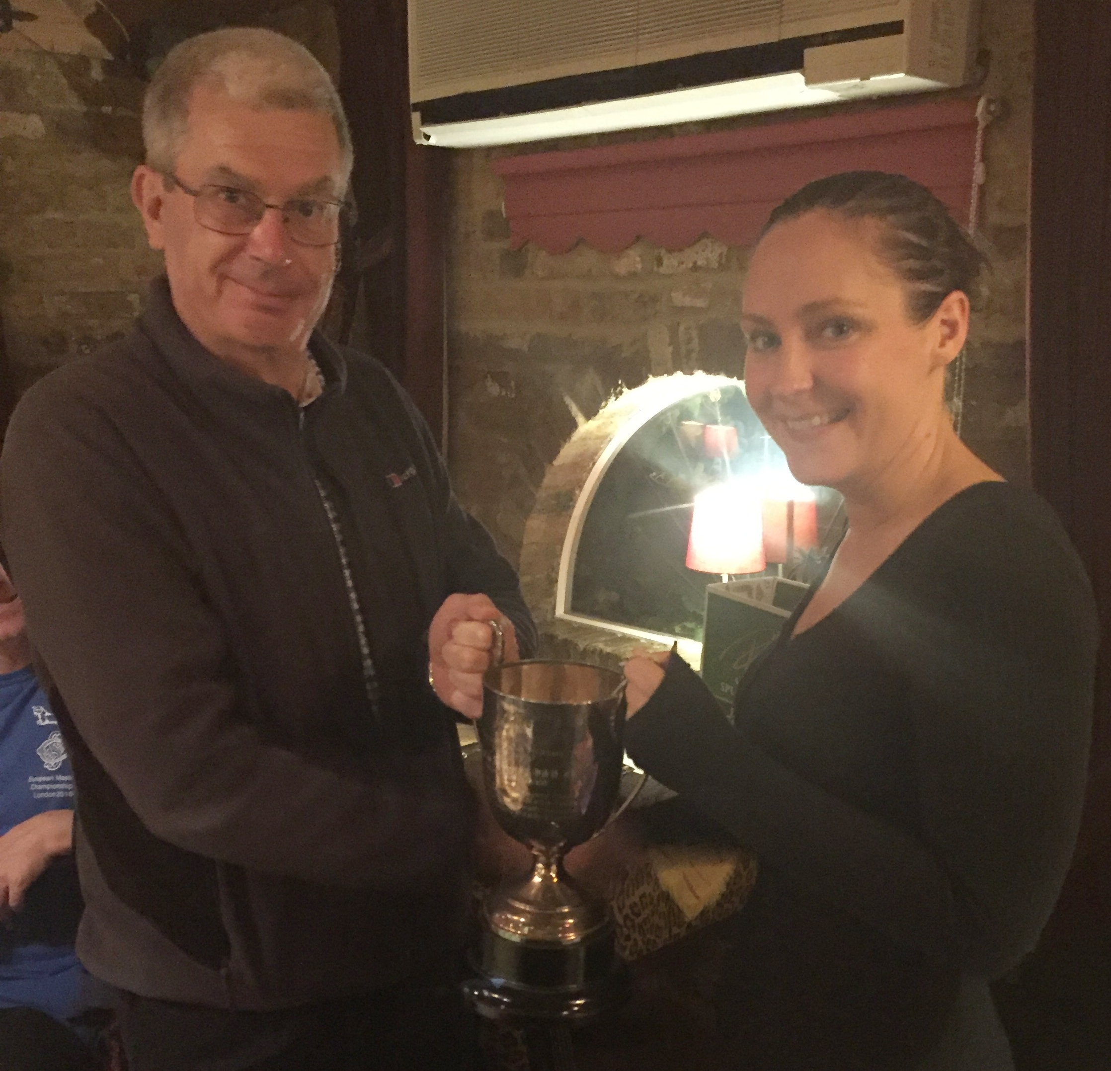 Women's and overall winner Hayley Davis receiving the trophy from President, Paul Hindle