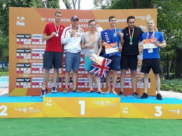 Dave (3rd from left) receiving his bronze medal