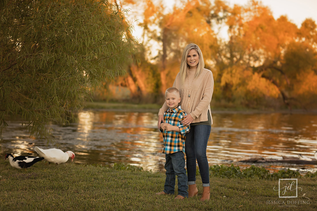 mom and son at pond in old settlers park