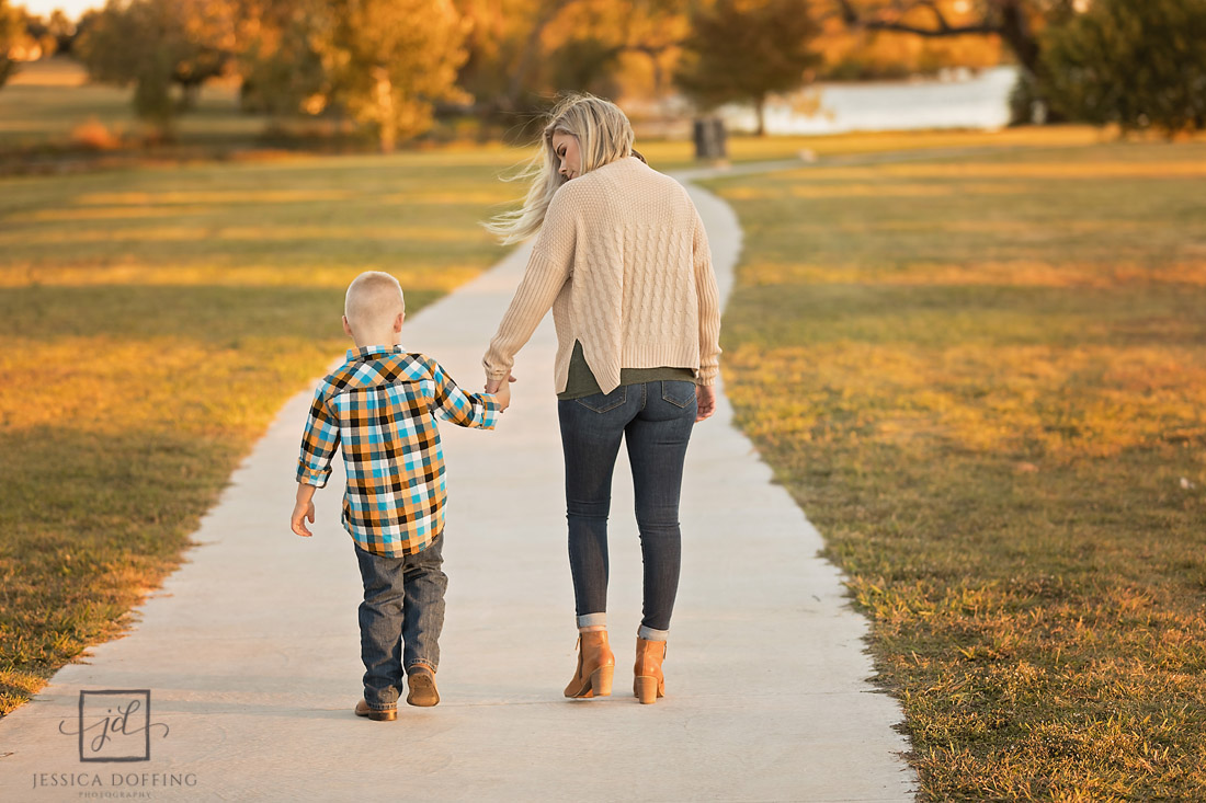 mom and son walking path old settlers park round rock