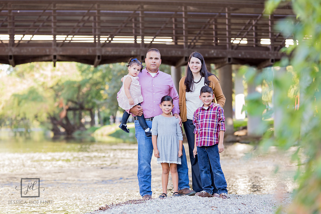 family by bridge at memorial park in roundrock texas