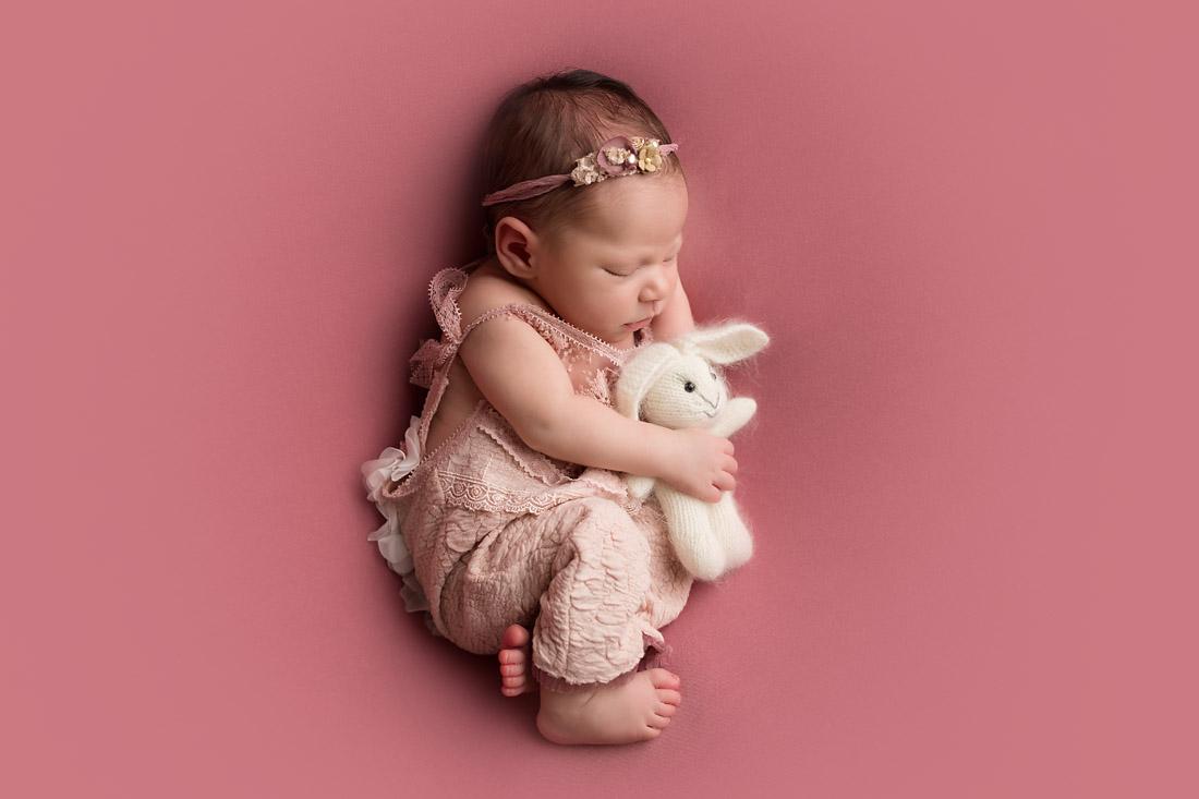 newborn with bunny prop
