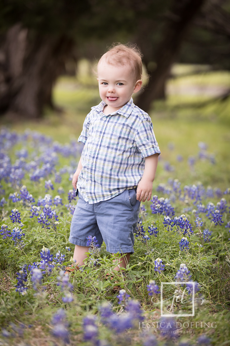 boy walking in bluebonnets