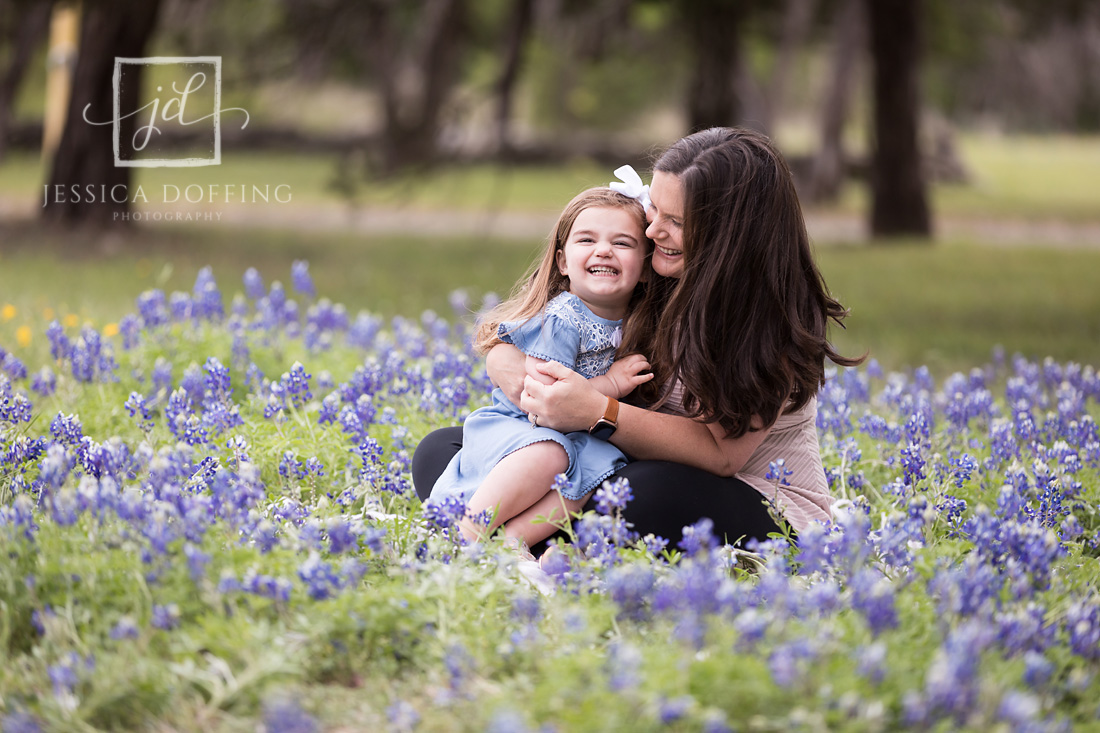 mom daughter laughing bluebonnets