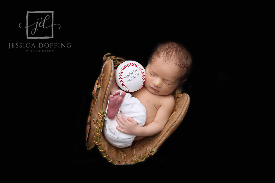 newborn boy in baseball glove