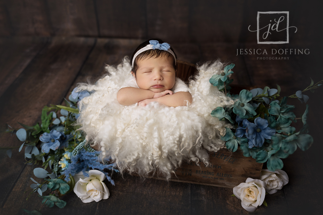 newborn girl blue flowers