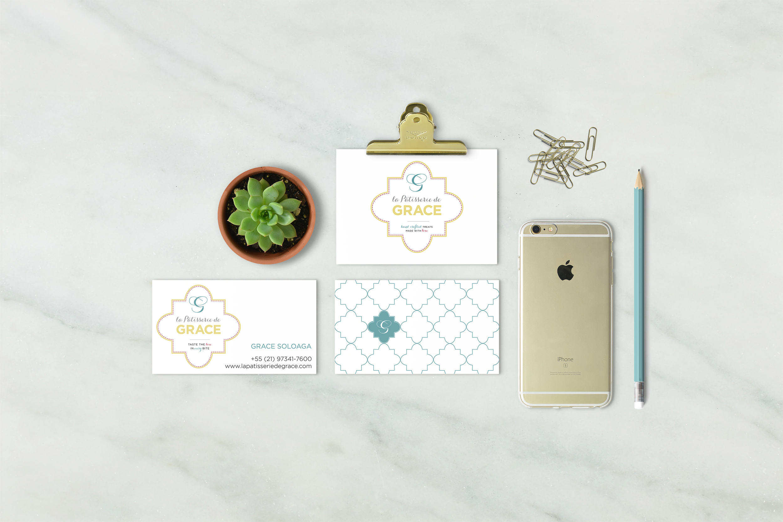 Branding implementation for La Patisserie de Grace, with clean flatlay of business cards and marketing post card