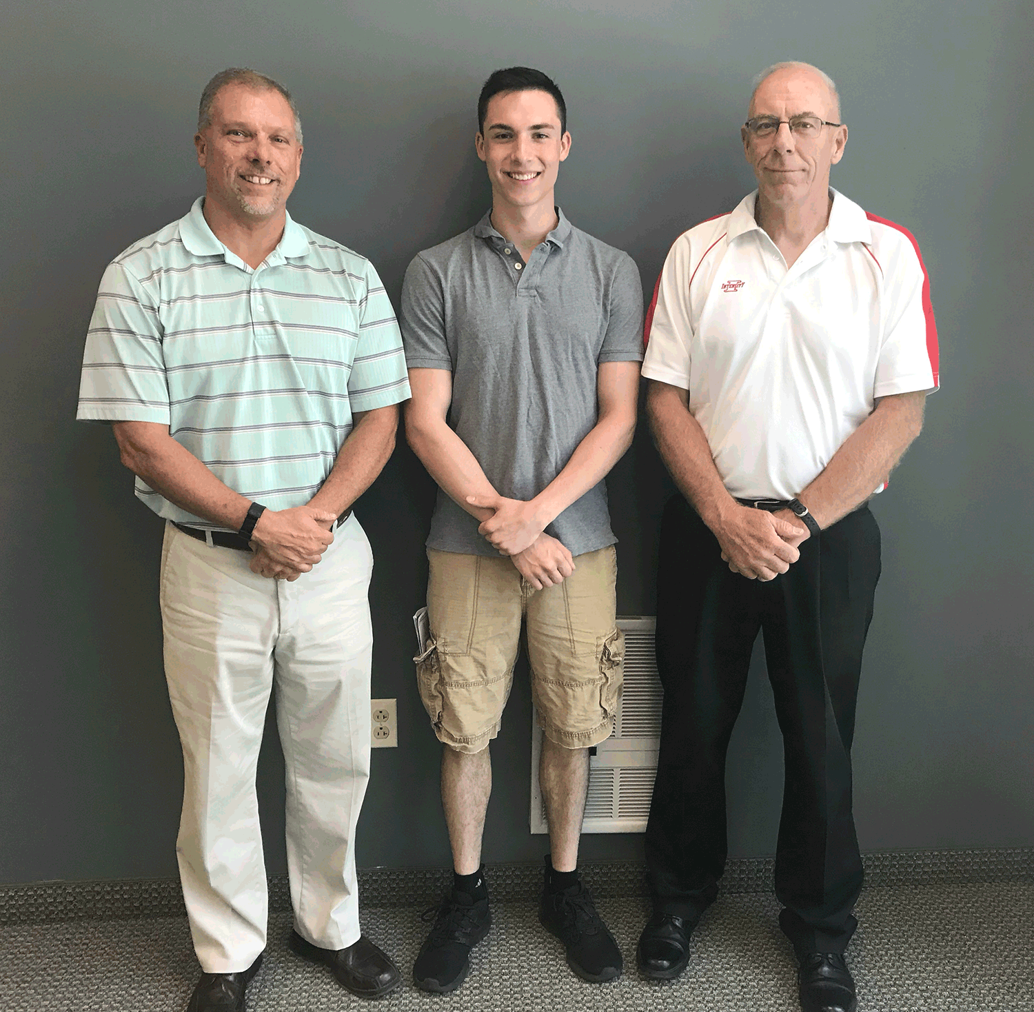 Gus Evans (c) after being prayed over by Redeemer Lutheran Church as he prepares to leave for United States Marine Corps bootcamp in Parris Island, SC. Gus is seen here with a couple of Redeemer's Marines, Ron Reimert (l) and Steven Koepsel (r).
