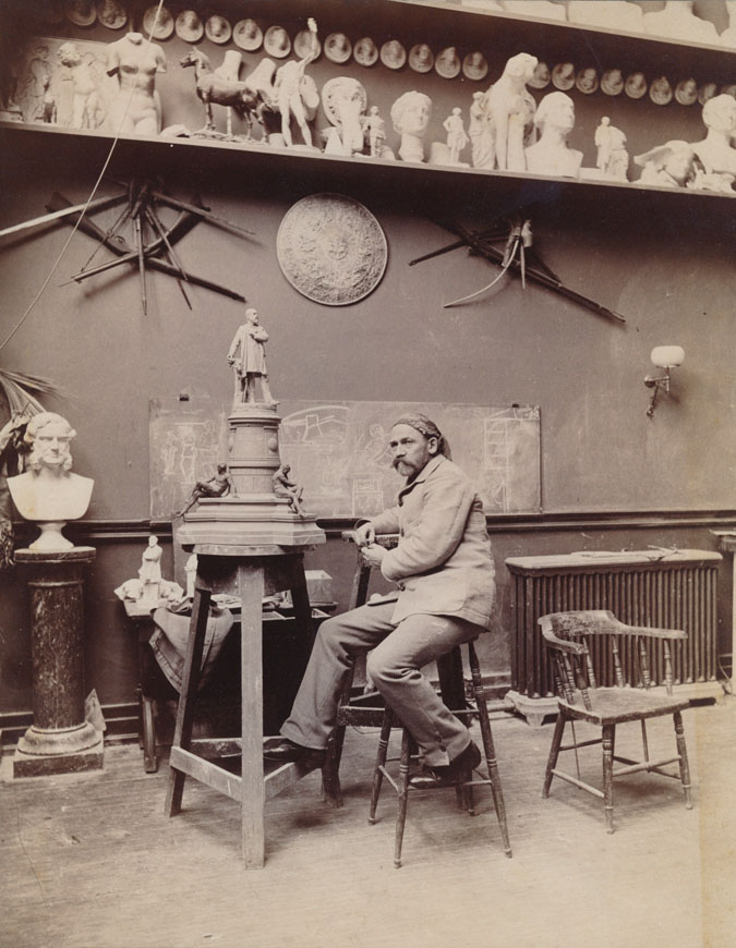 Ward in his studio, circa 1885, working on his model of the statue of President James A. Garfield