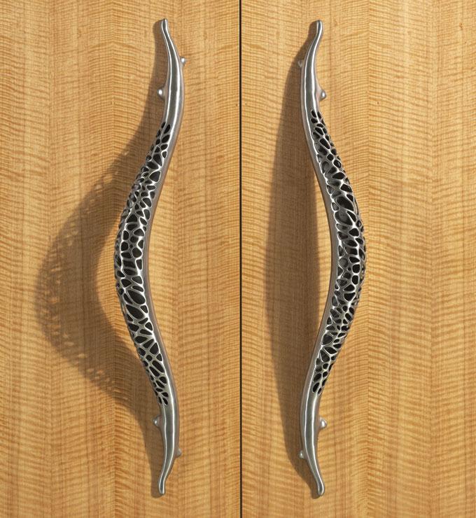 Morphic stainless steel door hardware from  Martin Pierce Hardware.  Photo by Doug Hill