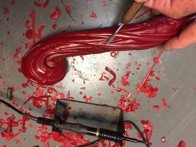 Using a heated scalpel and hand chisel Martin removes small imperfections from the wax