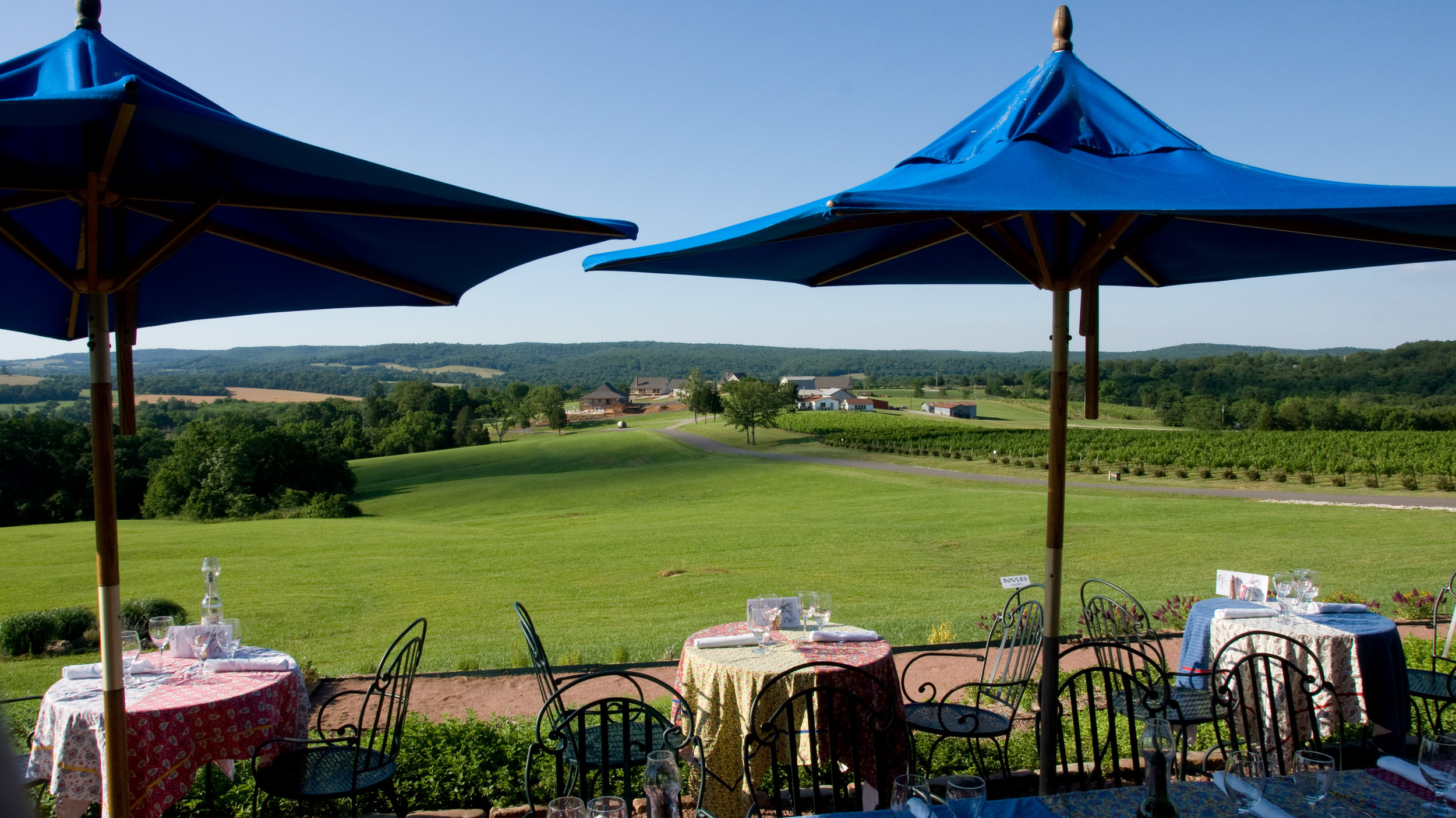 Panoramic views of rolling hills surround the outdoor seating area at Chaumette Winery.
