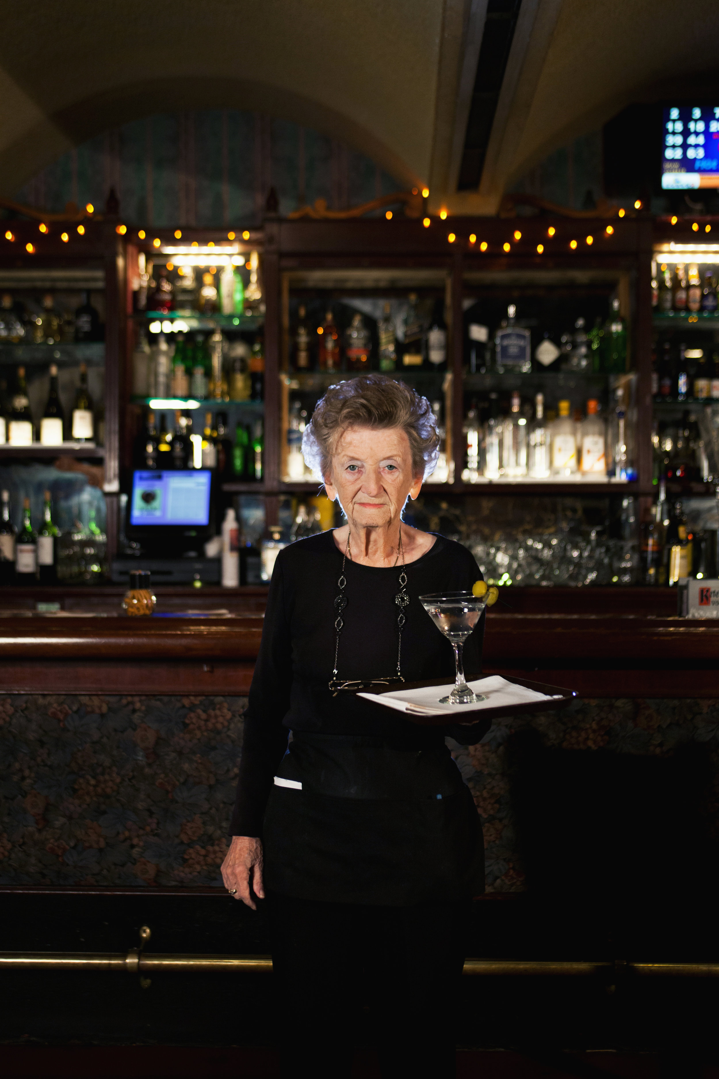 """Antonia Becerra - Antonia Becerra, 85, worked at Taix French Restaurant for 48 years. """"I got the job through a friend who used to work there and told me, 'You better come over and start working with us.'"""" She retired last year but continues to come in every Saturday. """"I never thought I'd be serving this long but it happened. The bosses were excellent."""""""