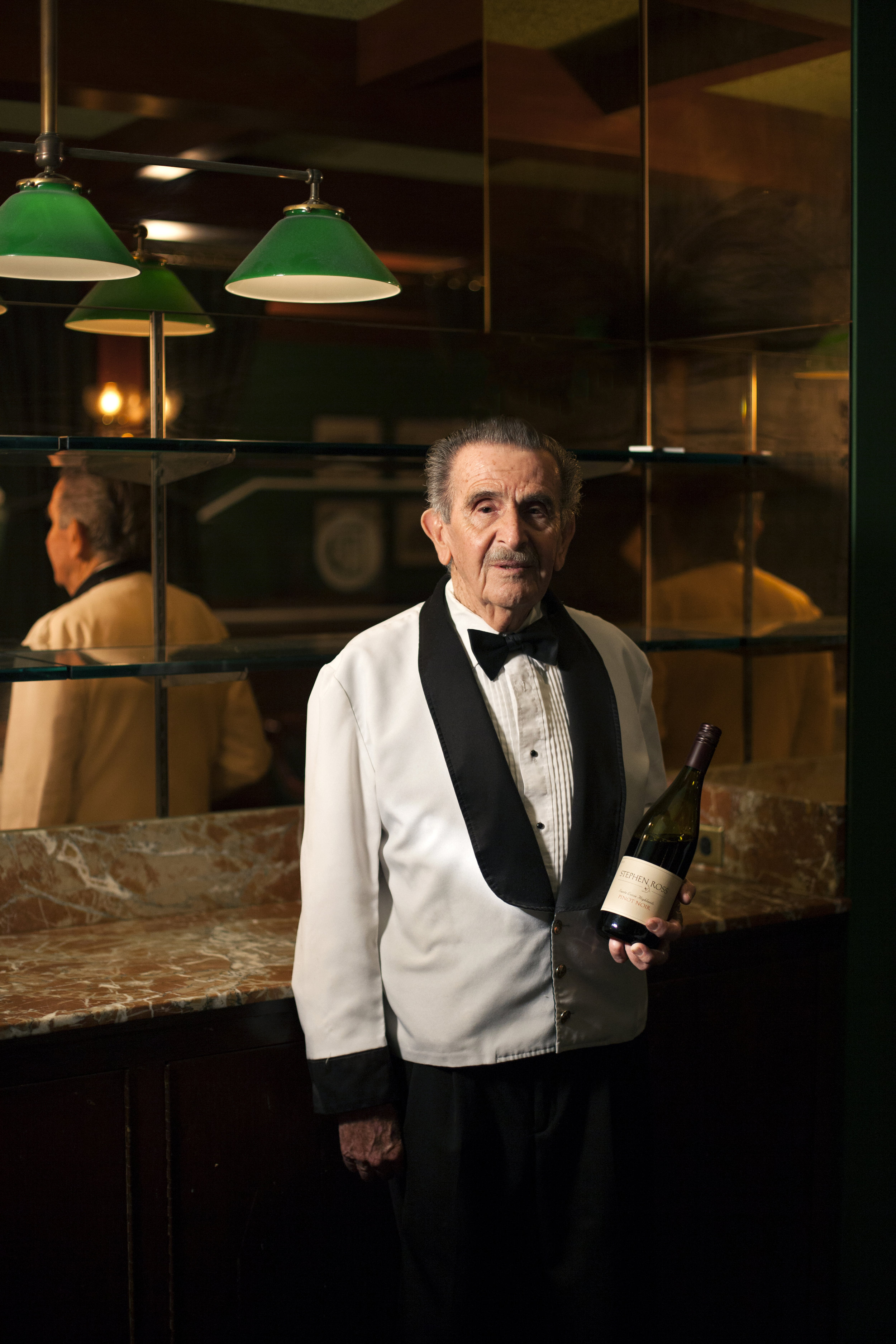 """Raffi Covarrubias - Rafael """"Rafi"""" Covarrubias is 84. He works the 6 p.m. to 2 a.m. shift five days a week at Pacific Dining Car in Downtown LA. """"I love this place. I like what I do and I make a decent living doing it. It also protects my sanity."""" A native of Guadalajara, Mexico, Covarrubias says he became a bartender by accident. """"When I moved to LA at the age of 25, I started washing dishes at a hotel. Then I got the opportunity to bartend."""""""