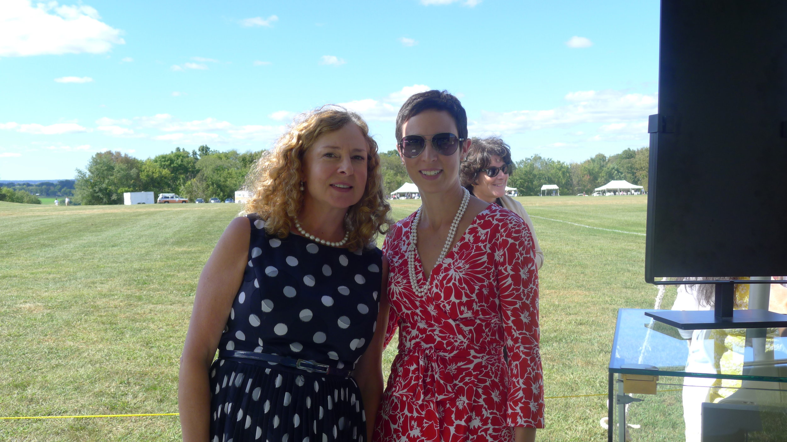 Suzanne Foster with Wendy, modeling our classic double strand pearl necklace in her perfect afternoon polo dress.