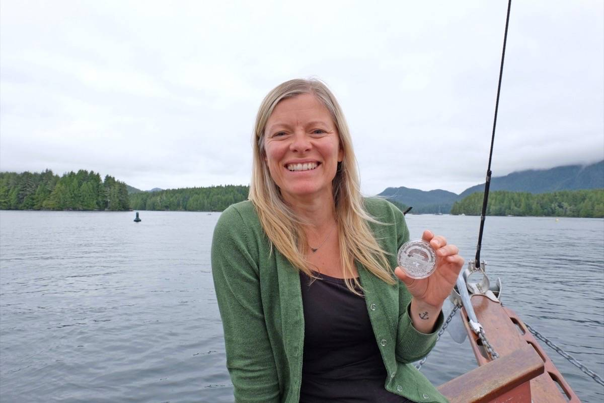 Artist Claire Watson holds '60 Years of Prominence: The St. Lawrence Seaway', her first silver coin designed for the Royal Canadian Mint. (Nora O'Malley / Westerly News)
