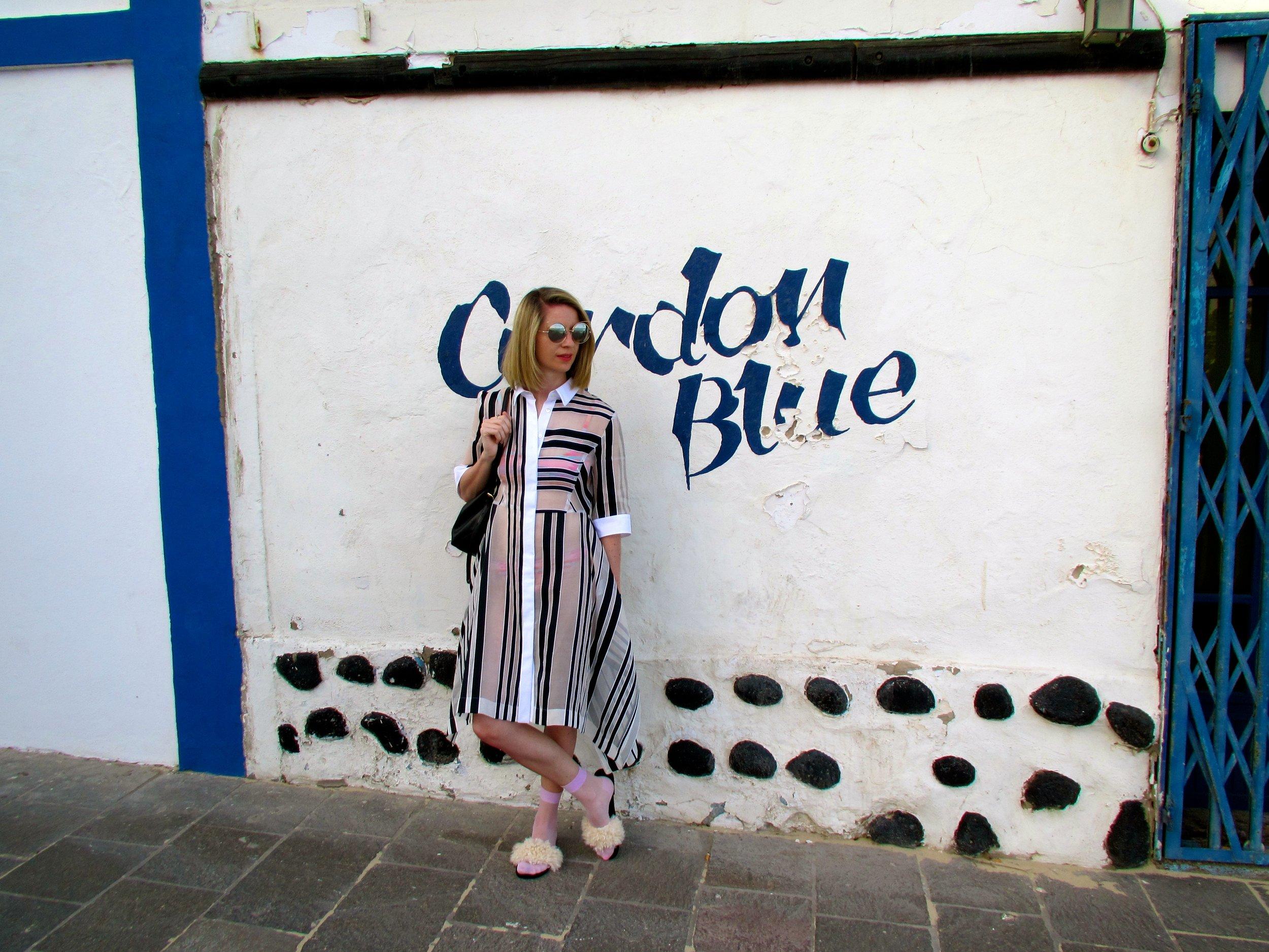 Striped sheer shirt-dress, Sportsmax, multi-coloured bikini, Topshop, fluffy sliders, Zara, pink sheer socks, Cos, cat-eye sunglasses, Topshop