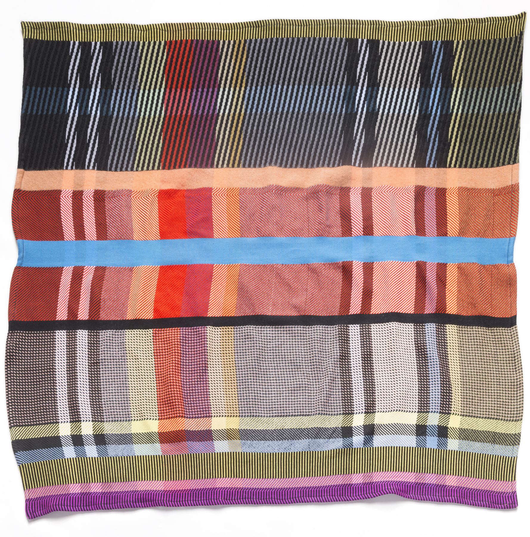 SW/TWM PLAID: Plaid comes from the Scottish Gaelic term  plaide , or blanket. This blanket is a complex plaid built out of the material, visual and structural terms developed by SW during her time at TWM. The final composition is a result of numerous iterations made at full-scale on the big loom.