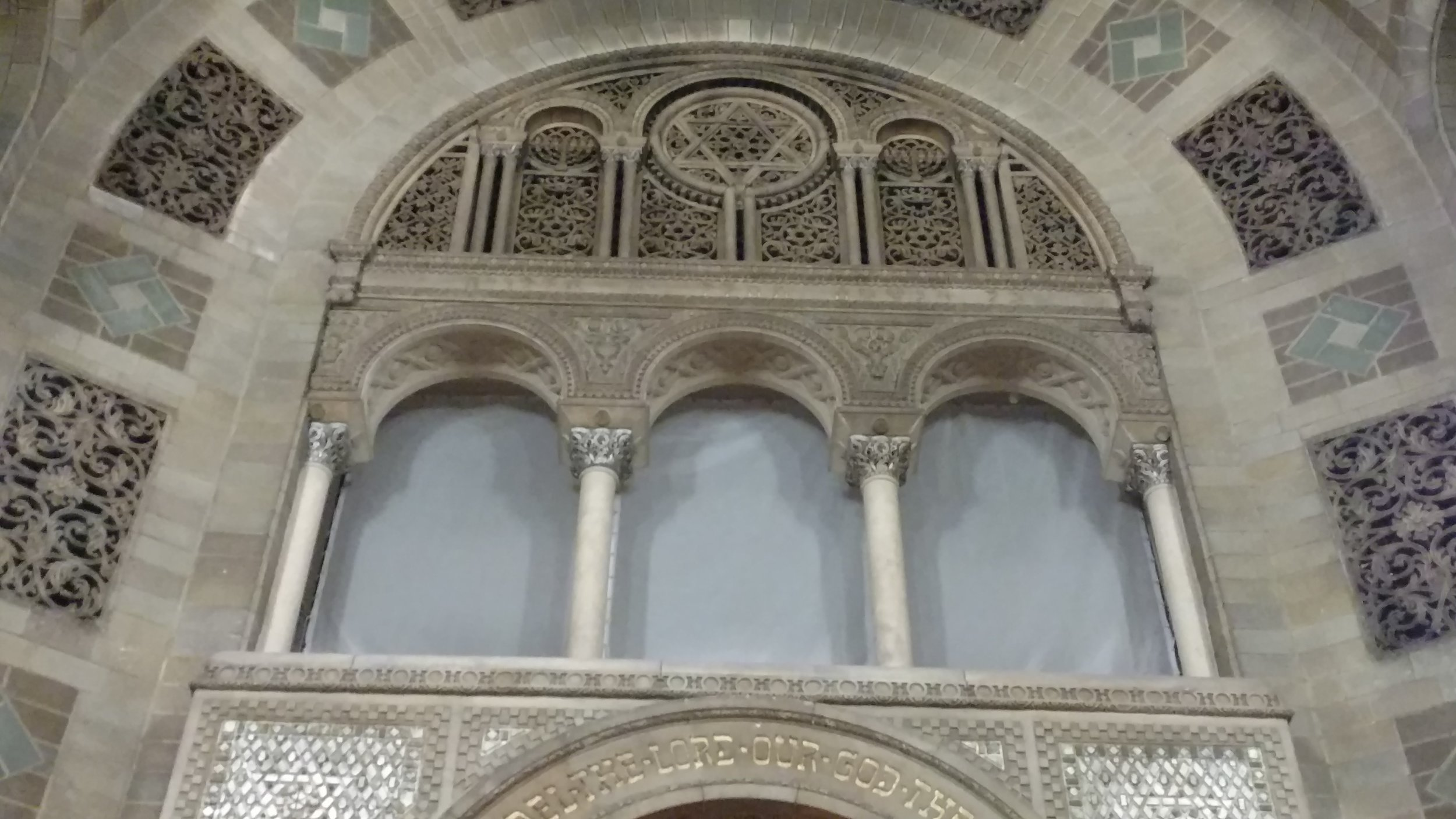 Carved arcade in synagogue sanctuary.