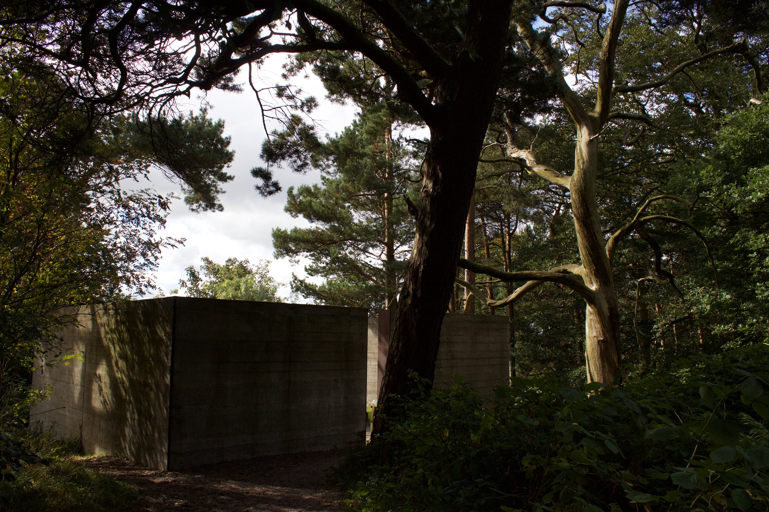 In Memory  by Nathan Coley (Enclosure yard formed from concrete with internal graveyard of headstones and planting)