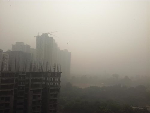"""View from my balcony at 11:15 am! Delhi NCR has become a hellhole. #smog""     (    @BBTheorist    )"