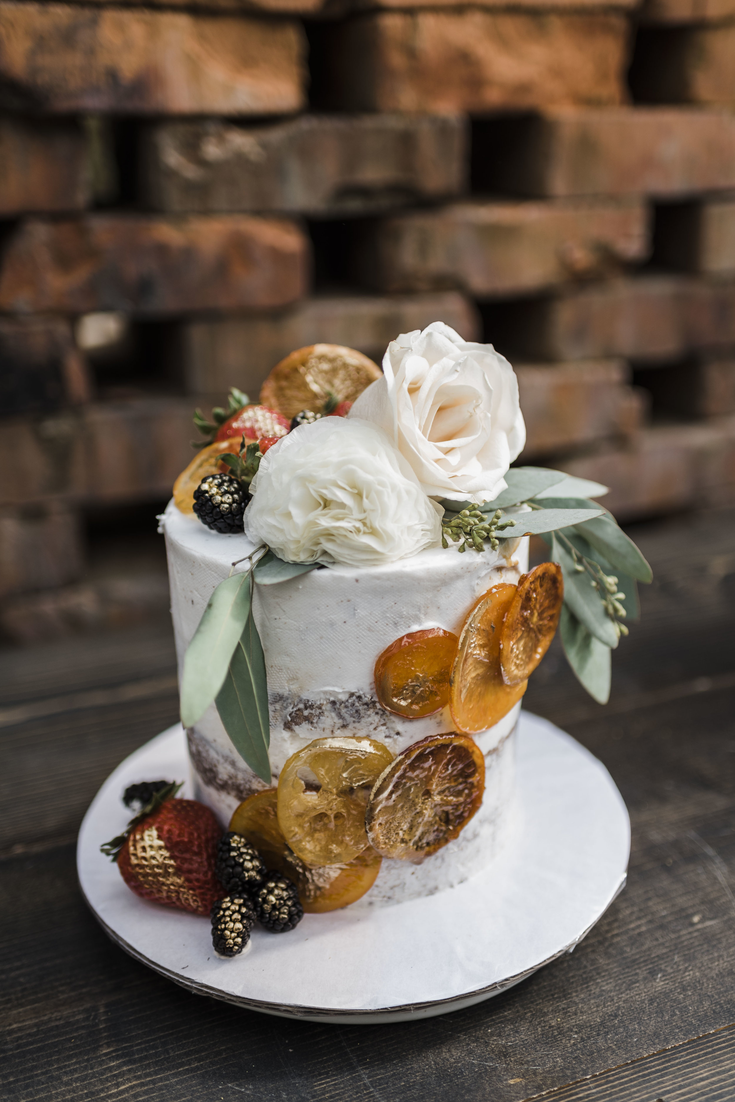 wedding cake oranges fruit gold flowers chattanooga Tennessee barn