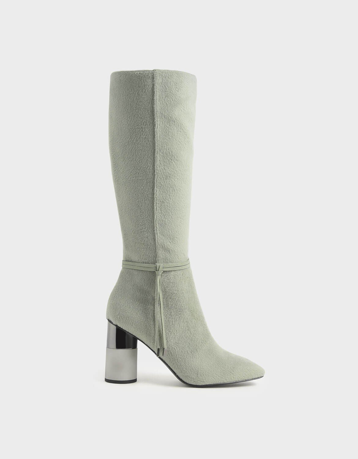 Calf Length boot… - This boot is by Charles Keith. I included a photo below from their instagram which shows a super cute way to wear these boots. If I buy these i'd def pair them with a green dress too.