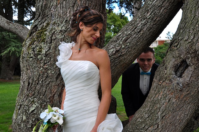 A real life example of bad wedding photography. The pose, the lighting, the entire concept is completely off.