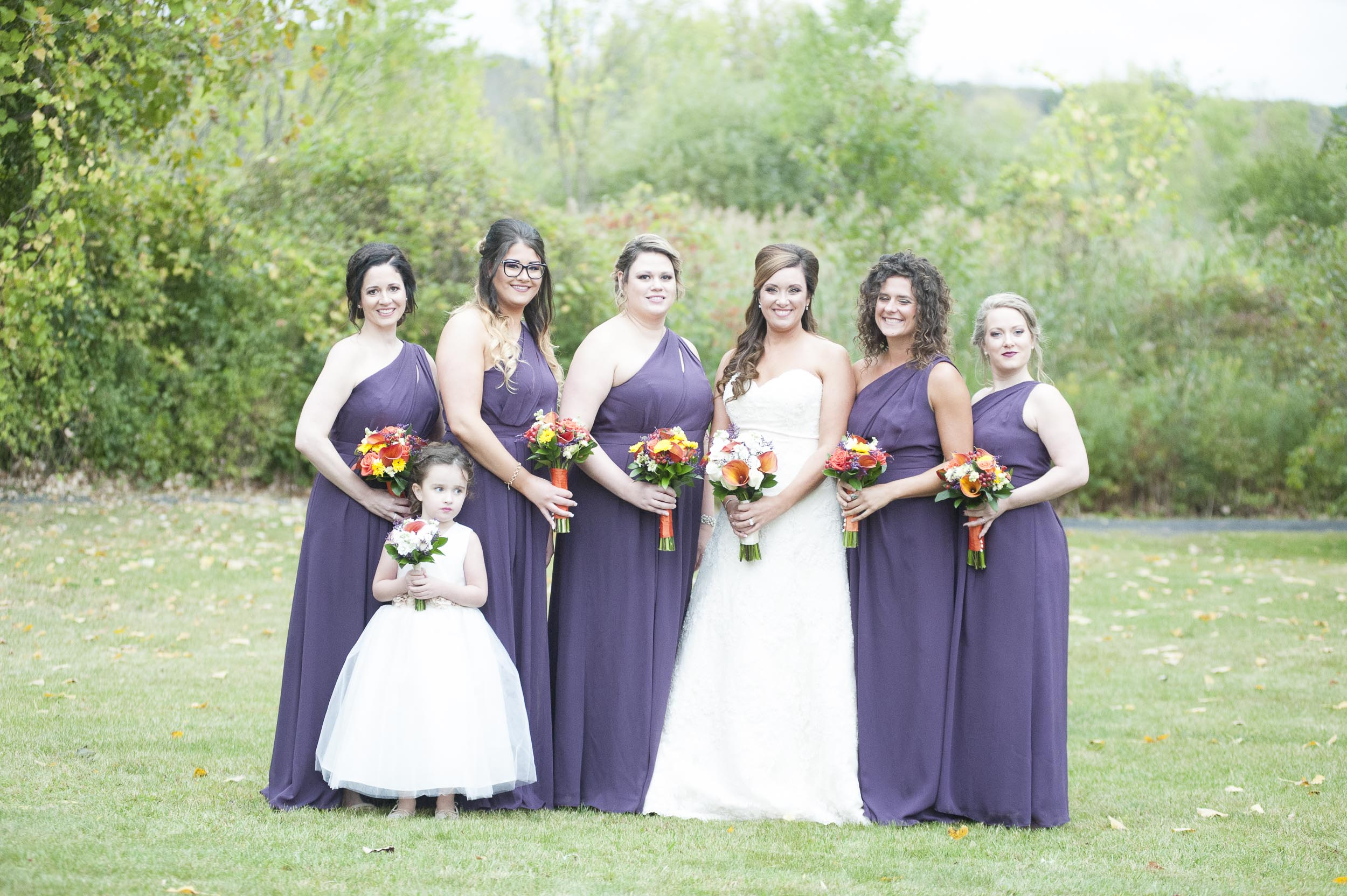 In this 3rd image, the bridesmaid 2nd from the right closed her eyes.
