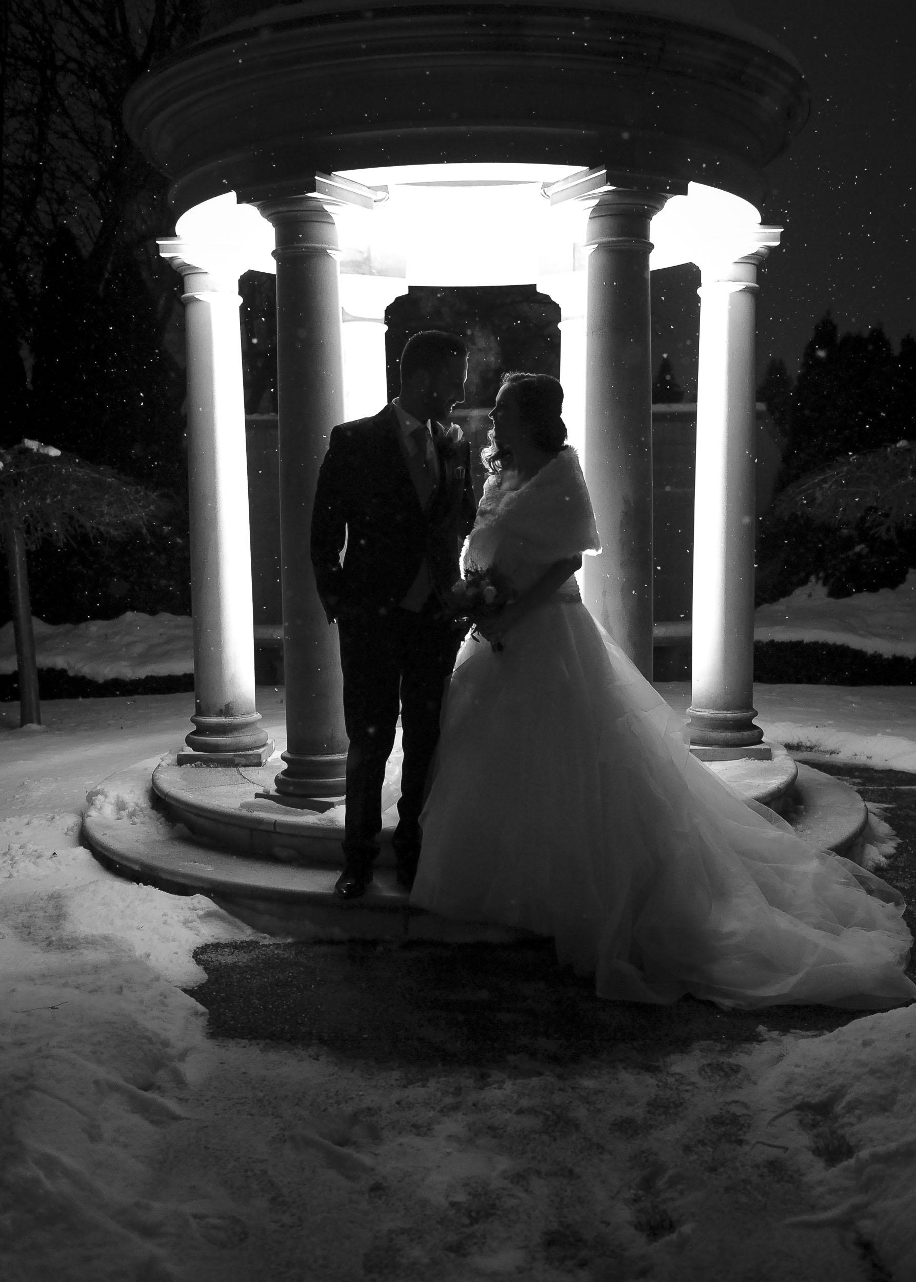 A romantic back-lit black and white photo on the gazebo.