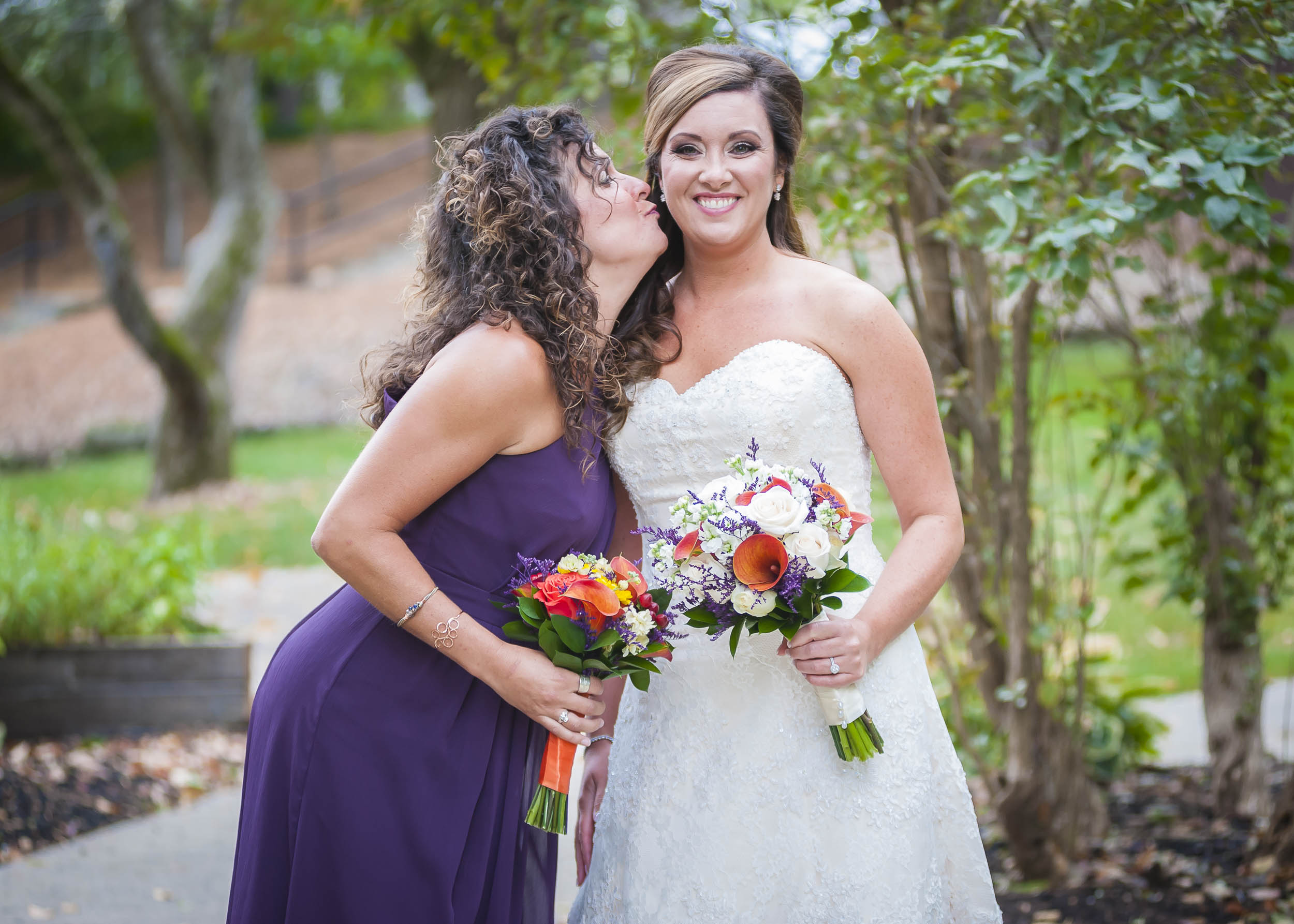 A bridesmaid showing the bride a little love.