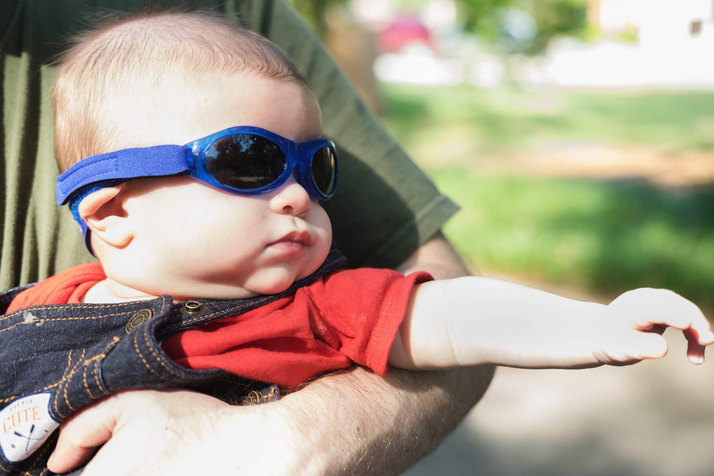 Overexposed with lots of blown highlights but I'm looking past all of that because......baby in sunglasses. ;)