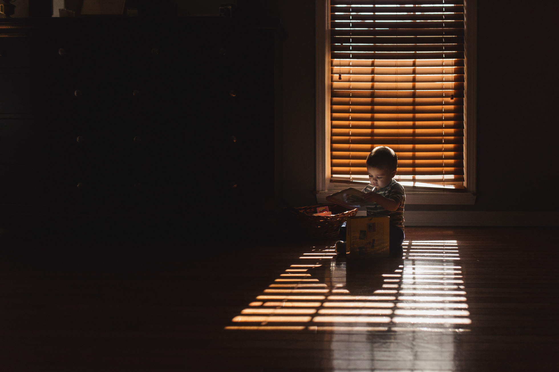 child_reading_beautiful_light_marietta_family_photographer.jpg