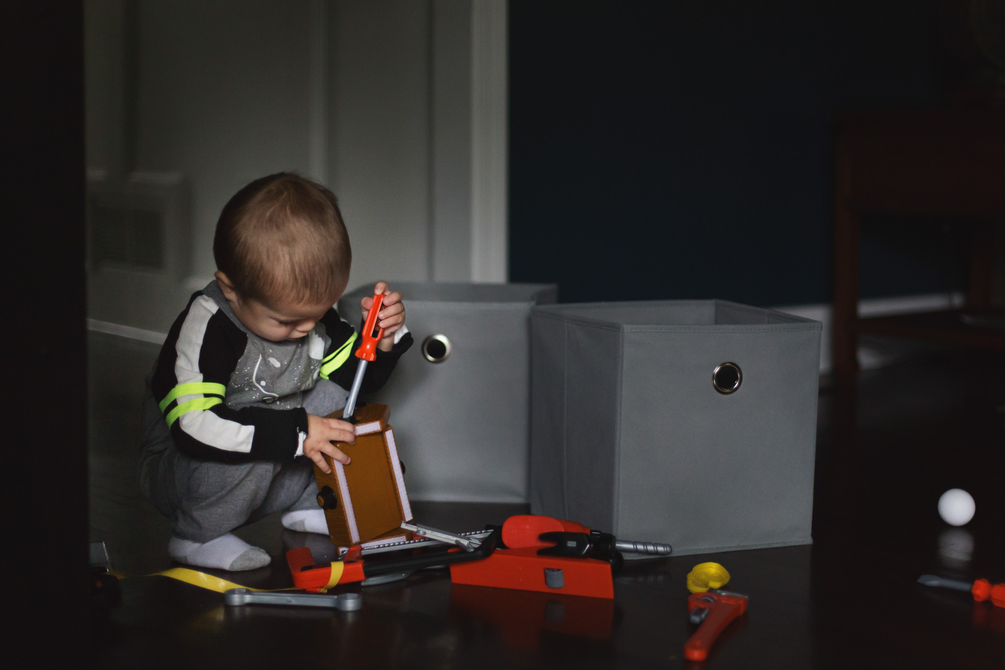 toddler_on_floor_playing_with_toys_marietta_family_photographer.jpg