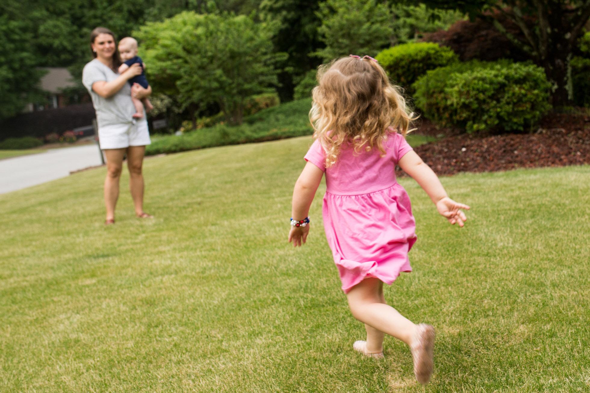 girl_running_toward_mother_marietta_family_photographer.jpg