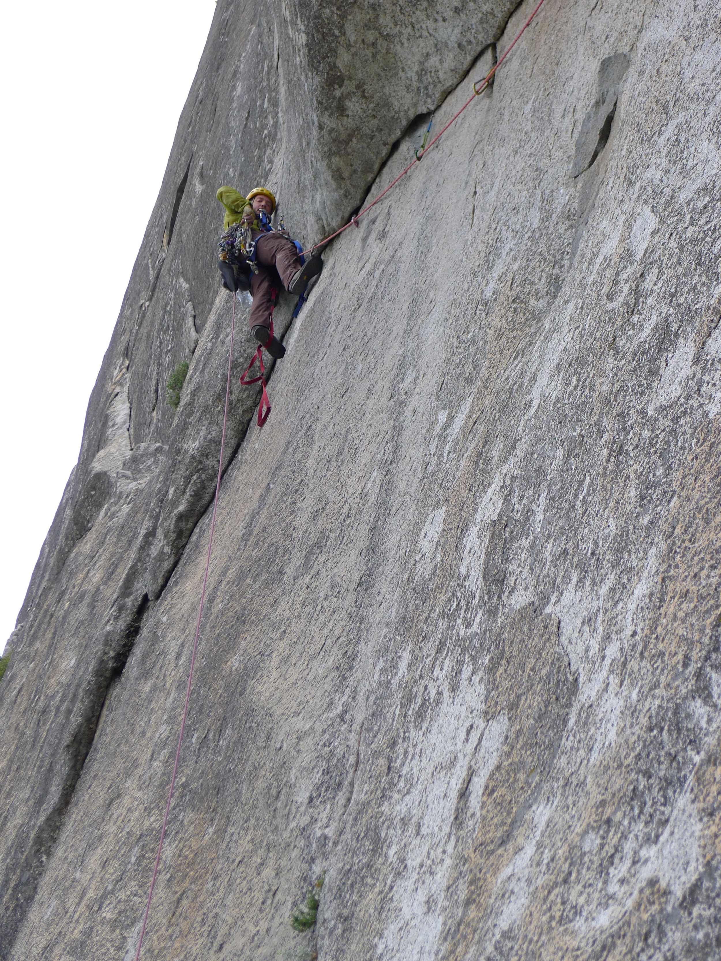 My longest aid lead of the trip, about 150' of an overhanging arch to a thin seam. The mental crux was stepping out of the aiders near the top and freeing a few 5.7 moves with a full aid rack on and in approach shoes!