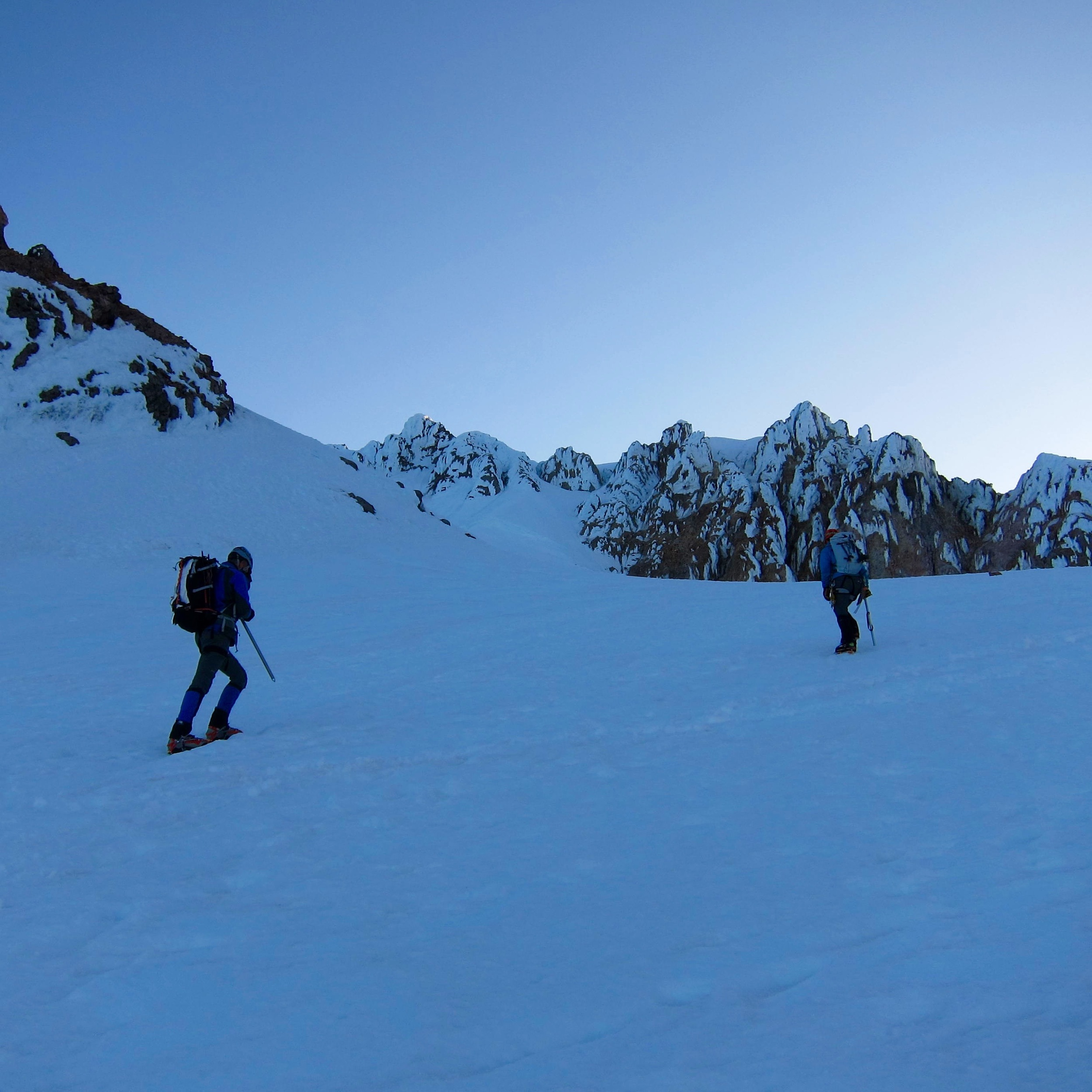 Heading up from the crater. The summit is above the buttresses in the center.
