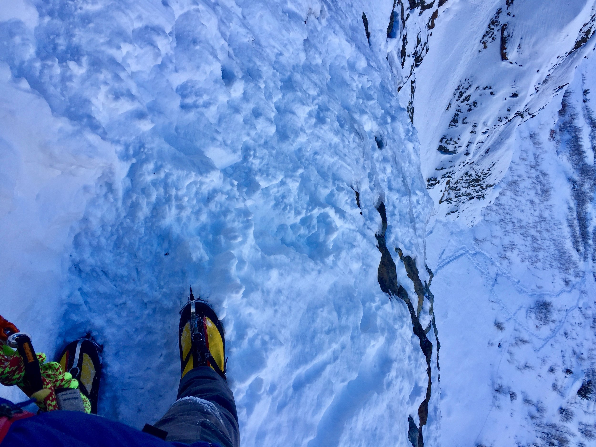 Looking down from the second belay to our tracks about 400' below.
