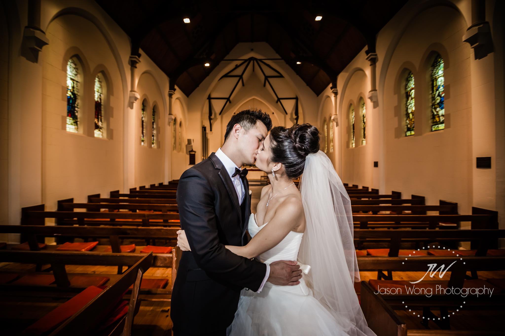 a-kiss-in-a-church-bride-and-groom.jpg